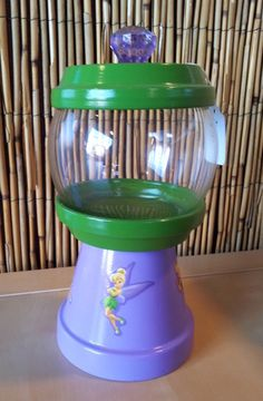 Customized/Personalized Fairy Inspired Gumball Machine Candy Jar. Can be used for candy, nuts, change, beta fish, q-tips, cotton balls, hair pins or anything you can think of. Visit Julie's Kraft Shack @ https://www.facebook.com/JuliesKraftShack