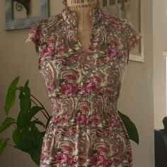 FLOWER PRINT DRESS from אותנטי Beautiful midi flower print dress from Israel. Cap sleeves and high collar. Waist has elastic which can be tied in back with attached fabric to make size more wearable to all. Plz see pix. Worn Once, condition is like New!!! Dresses Midi
