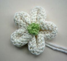 Mack and Mabel: Knitted Flower Tutorial- tried this, it looks good with a button in the middle