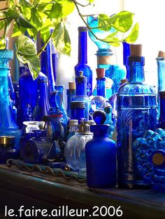 I have a collection just like this one. The sun through the glass just lightens my heart. LOVE color. Assortment of blue bottles.