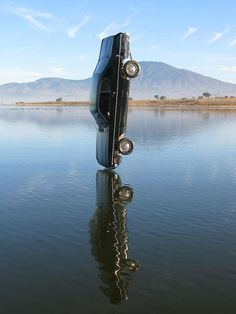 blazepress:  A car the moment before it hits the water.: