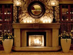 cozy candles decorate the fireplace