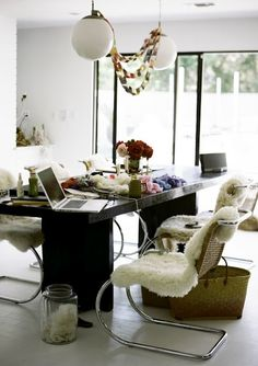 table and chairs and fur #workspace #apple #mac #interior #decor #officespace #desk #flowers #chair