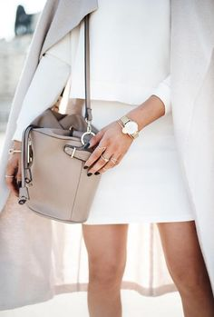 Whites and neutrals meet one of our favorite bags this season — a leather bucket bag.