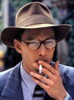 """Andrew McCarthy as Henry Miller in """"Jours Tranquilles à Clichy"""". I have to see this! """"The Quiet Days of Clichy"""" Andrew Mccarthy, Henry Miller, Stars Play, People Smoking, Actor Studio, Hot Guys, Hot Men, Hats For Men, Tv"""