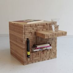 PixelTabel>>>>>This table is also a versatile cupboard; you can place something in it, and on the other side the sticks where the table is made of, come out. The sticks of the table can be formed into a cube again, and it will adjust itself to every other content.    Material: bamboo