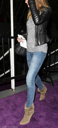 black leather jacket, gray tee, jeans, and taupe ankle boots