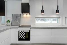 Tyylikäs betonitaso modernissa keittiössä
