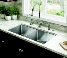 Picking a kitchen sink is a huge part of kitchen restoration. From typical top-mount sinks to newer, trendier devices like the reduced divider panel sink, think about which sort of sink suits your . Read Basic Kitchen Sink Types Ideas You Must Know Best Kitchen Sinks, Kitchen Sink Design, Kitchen Sink Faucets, Cool Kitchens, Kitchen Sink Ideas Undermount, Bar Sink, Franke Kitchen Sinks, Remodeled Kitchens, Basic Kitchen