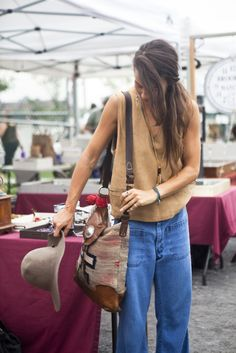 Great style! Especially love her Navajo bag.  thenycstreets:    @bkflea @grandstbakery  Heather works in the Visual department at Ralph Lauren (mostly the new amazing flagship mansion store at 888 Madison Avenue)  Bag - Ralph Lauren  Top - Neal Mello from The Bakery vintage store in Brooklyn.  Not sure about the hat and jeans but probably also vintage.  She is inspired by vintage clothing, ethnic pieces. Her style icons are Erin Wasson, Janice Joplin, and Jimi Hendrix.