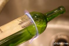 Tie string around bottle, slide off and soak in acetone for 10 secs, slide back on, light on fire, as soon as fire goes out, submerge on ice cold water. how to break a wine bottle
