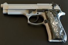 92FS INOX Beretta with Hogue custom grip with Naval Officer Surface Warfare Emblem - www.Rgrips.com Find our speedloader now! http://www.amazon.com/shops/raeind
