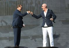 """Pitbull Photos - Frank Del Rio (L) and Armando Christian Perez """"Pitbull"""" onstage at the Christening Ceremony for Norwegian Cruise Line's newest ship Norwegian Escape at Port Miami on November 9, 2015 in Miami, Florida. - Norwegian Escape Christening Ceremony"""