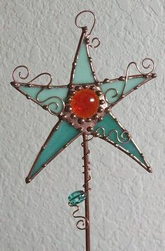 Google Image Result for http://www.ebsqart.com/Art/Art-Stakes/mixed-media-stained-glass/383820/650/650/Magic-Wand-Stained-Glass-Garden-Art.jpg