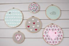 Grab yourself a pack of fat quarters and a pack of embroidery threads, and you're all set to get making your very own set of wall art!