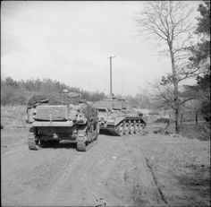 Stuart recce tank and Comet of 23rd Hussars, 11th Armoured Division, 3 April 1945.