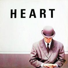HEART – this should be an exciting song about falling in love but the tone in his voice, and especially the visuals of the single sleeve (sombre hatted heads pointed down) and the video (Dracula steals the bride), signals dread.