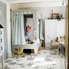 Adorable child's room. Great Painted floor and love this bed.