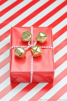 Cute, unique and easy way to wrap a gift for the Christmas holidays! I love the Jingle Bells! Via Kara's Party Ideas   Kara Allen   KarasPartyIdeas.com for Michaels #MichaelsMakers #KaraAllen #KarasPartyIdeas-3