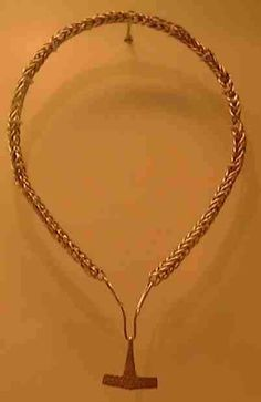 Wish I could find the actual link to this rather than just the link to the picture.  This looks to me like a 4 stranded braid.  I've been working with making braided jewelery.   Thor's Hammer pendant from the Danish National Museum.