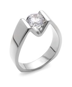 The Blissful engagement ring contains 1 diamonds, totaling 0.005 ctw. Center stone sold separately, not included in price.The Blissful wedding band contains no diamonds.