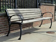 wooden bench with black metal frame