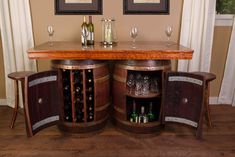 Wine Barrel Bar/Island Set with 4 Stools  This set comes with 2 reclaimed wine barrel bases. One base has a 28 bottle wine rack inside and the other has an internal lazy susan shelf. The table top is made from solid white oak with hardwood trim. The set includes 4 wood stools made from the wine barrel staves.