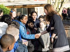 Nice to meet you: Many of the children are among those being given art therapy by The Art Room, of which the Duchess is patron