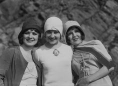 1920s. I think the one in the middle is wearing a brooch with her and her guys picture.