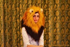 Dress like the king of the jungle with this hand-made lion hood, tail and mittens set! Lion accessory set includes: The most impressive lions mane hood youll ever see! Realistically crafted with three different colours of fur - honey brown, ginger and black/brown to make it just like the real thing! A little pair of lion ears made of realistically trimmed cream fur and black fleece sit atop the mane, making it look super cute! The mane is worn just like a hood - it sits on your shoulde...