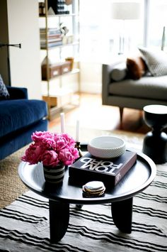 "The living room's sculptural coffee table is a personal favorite of the designer. ""I have to give credit to Liza, a designer who works with me, for pushing me and the client in this..."