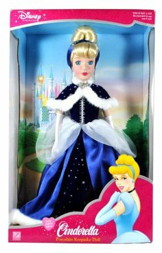 Brass Key Keepsakes Year 2003 Disney Princess Collectible 16 Inch Porcelain Doll - Royal Holiday Edition CINDERELLA with Blue Gown, Evening Gloves, Earrings and Headbands by Brass Key. $99.99.  The Fairy Godmother granted sad and  lonely Cinderella's wish to go to the Royal Ball. Cinderella arrived at the Royal Ball  in her magnificent coach drawn by graceful white horses, and wearing the  beautiful blue gown...
