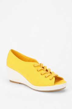 They have these in black but I somehow think canary yellow shoes with an all black outfit is way goth.  urbanoutfitters.com