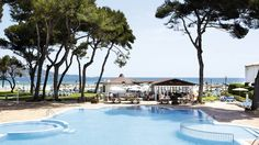 :D - Majorca - spa - majorcas best beach right there - huge swimming pool - buffets - amazing location scenically - mini golf/tennis - bistros nearby - posh - award winning hotel - champion hotel price two years running - four star - £593 pp - half board