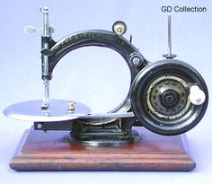 """❤✄◡ً✄❤  Named the """"Little Belle"""" and produced during the 1870's, this pretty miniature chain stitch machine features a forward-facing drive wheel. It is reasonable to assume that it must have been a relative commercial failure for very few examples have survived. - http://www.dincum.com/library/lib_littlebelle1.html"""