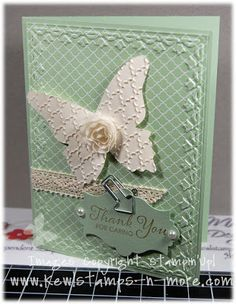 Using Stampin' Up! Tulips and Fancy Fan embossing folders along with Butterfly die and vintage lace.