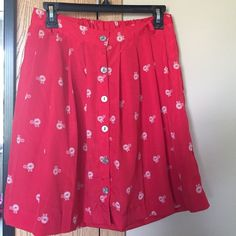 Red bicycle skirt Xhilaration red bicycle button front skirt. Size small Xhilaration Skirts