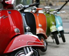 Vespa lineup...I promise to have one of these and be an old lady driving it around. My kids will have me committed!
