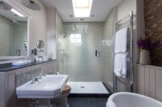 Bathroom of room 23 at Tudor Farmhouse Hotel, Clearwell. Tiles from Tons of Tiles.