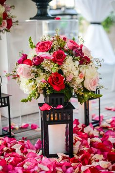 Lantern aisle decor with red, pink and white roses at a Disney wedding at Sea Breeze Point