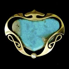 Murrle Bennett, gold and turquoise brooch.
