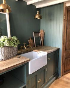 Are you bold enough for this green? This might be a simple rustic setting but there's much to appreciate in it. We adore. Home Design, Küchen Design, Rustic Kitchen, Country Kitchen, Boot Room Utility, Utility Room Designs, Mudroom Laundry Room, Green Kitchen, Home Kitchens