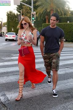 Bella Thorne walks arm-in-arm with Teen Wolf star Tyler Posey #dailymail