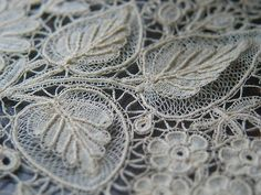 """In the close up of Brussels Duchesse Lace belowone can follow the clean lines of the threads and there is no """"fuzzy"""" or messy looking work. (the picture gets fuzzy at the edges, but the lace threads aren't)"""