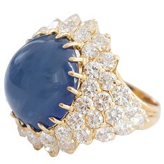 17 Carat Natural Cabochon Sapphire Gold Cluster Ring | From a unique collection of vintage cluster rings at https://www.1stdibs.com/jewelry/rings/cluster-rings/