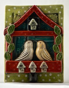 I love the color and whimsy of this tile!  Fireplace decor??