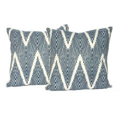 """This pair of decorative 20"""" x 20"""" pillows are handmade in designer fabric in beautiful shades of navy and ivory. The pillow covers are handmade from"""