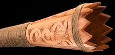 Pukaea - made of Kauri A long wooden war trumpet . It is made in the same way as the putorino, hollowed out in sections and joined together again. The flare at the lower end is made by joining together a number of triangular wedges of wood which are gummed and bound to the end of the pipe. A few inches above the bell end, a tonsil or vibrating reed has been inserted in the pipe, perhaps in imitation of the human throat,