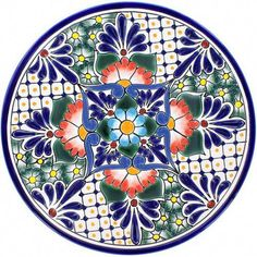 Mexican talavera plates are used for dining and decorating kitchen walls. A cobalt, orange, green and white plate from Mexico is microwave safe. by Rustica House Ceramic Plates, Decorative Plates, Kitchen Decor, Decorating Kitchen, Kitchen Walls, Mexican Ceramics, Mexican Kitchens, Talavera Pottery, Diy Kitchen Remodel