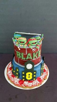 TMNT cake with fondant turtle heads and cookie cake pizza underneath. www.facebook.com/cakesmadebychrissy